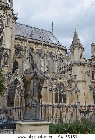 Jean-paul Ii Sculpture At Notre Dame De Paris, France