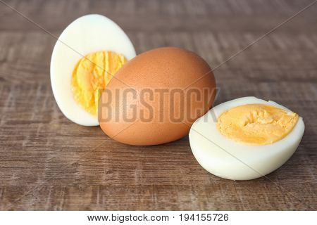 Hard boiled eggs on wooden surface. Nutrition concept