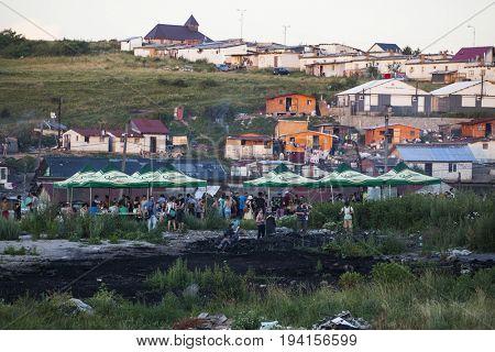 Cluj-Napoca, Romania - 27 June 2017:  Houses of the isolated romai community in Pata Rat, the rubbish dump near Cluj-Napoca, Romania