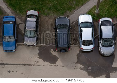 Yoshkar-Ola Russia - June 14 2017 Photo of cars parked on a lawn in one of the streets of Yoshkar-Ola Russia
