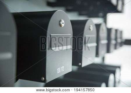Close up of rows of mailboxesoutside of post office.
