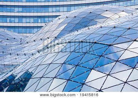 Blue roof in modern building made of glass and steel