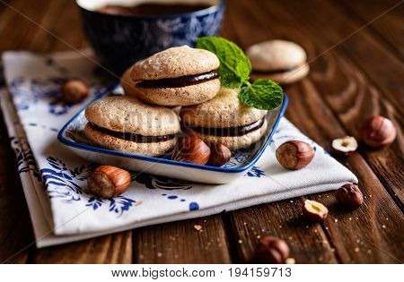 Hazelnut shortbread sandwiches filled with chocolate cream