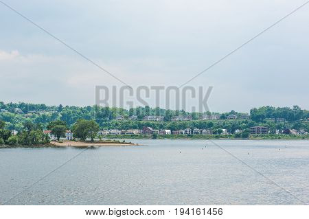 Harrisburg Pennsylvania skyline from riverfront park with residential houses and city island