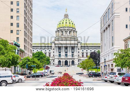 Harrisburg USA - May 24 2017: Pennsylvania capitol exterior in city with many red pink rose bushes and street