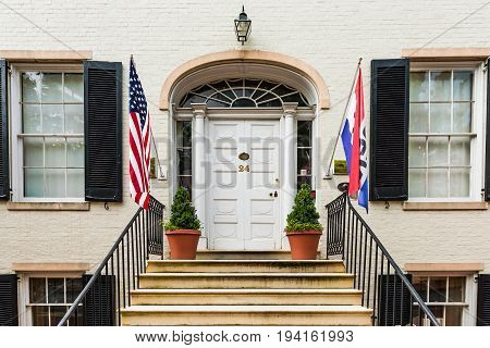 Frederick USA - May 24 2017: Historical Society of Maryland entrance door in downtown city with sign and flags