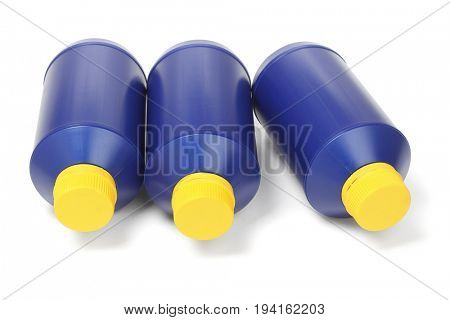Three Blue Plastic Bottles Lying on White Background