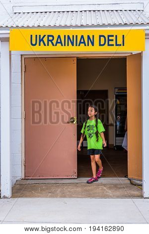 Silver Spring USA - September 17 2016: Ukrainian deli sign with young girl walking out of door entrance at festival