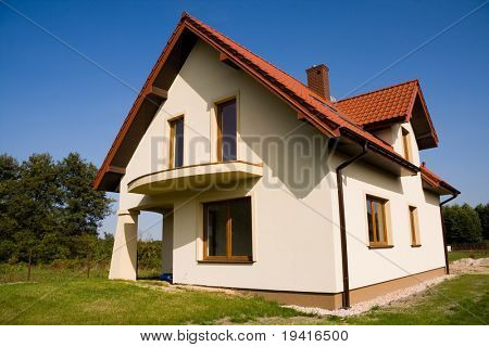 Single family bright house over blue sky