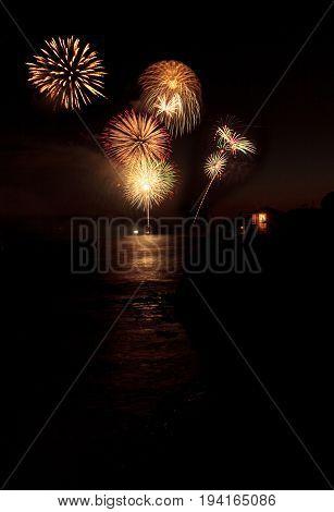Laguna Beach CA USA - July 4 2017: Colorful explosion of fireworks over the Emerald Bay beach in Laguna Beach.