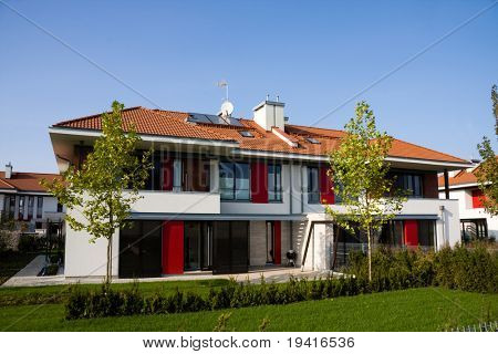 Single family yellow medium house over blue sky