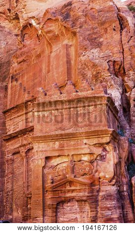 Rose Red Yellow Rock Tomb Street of Facades Petra Jordan. Built by the Nabataens in 200 BC to 400 AD. Rose Red canyon walls create many abstracts close up. Inside the Tombs the rose red can become blood red. Reds are created by magnesium in sandstone.