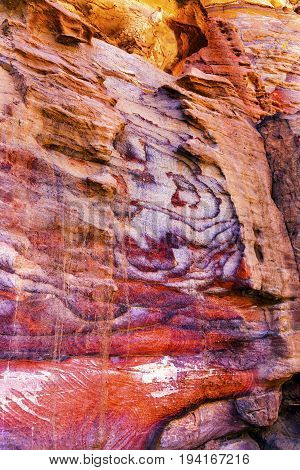 Red Rock Abstract Petra Jordan Built by the Nabataens in 200 BC to 400 AD. Rose Red canyon walls create many abstracts close up. Inside the Tombs the rose red can become blood red. Reds are created by magnesium in sandstone.