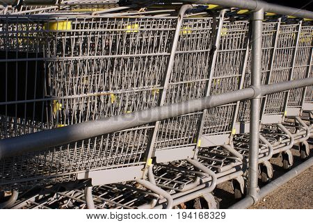 Closeup of several shopping carts at the mall return centre.
