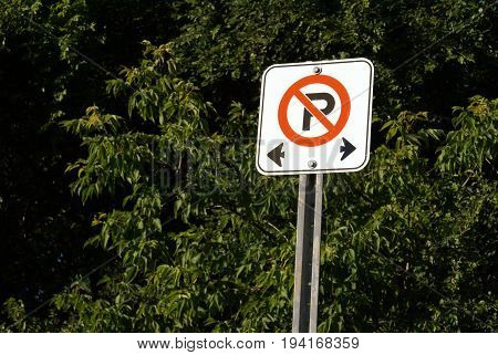 A no parking restriction area is communicated through this street sign.