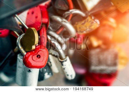 Red locks in the form of a heart. Metal locks. A bunch of locks. Heart locks