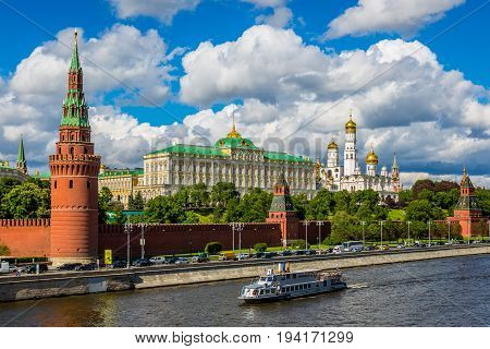 The Kremlin wall along the Moskva River with views of the Armoury Chamber Great Kremlin Palace Cathedral of the Annunciation & multiple towers in Moscow Russia.