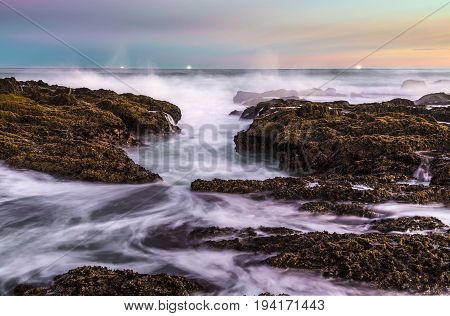 Long exposure of the sea waves and rocks at the coast in South Africa