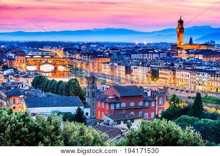 Florence Italy - Ponte Vecchio Palazzo Vecchio and Arno River night in Tuscany Toscana.