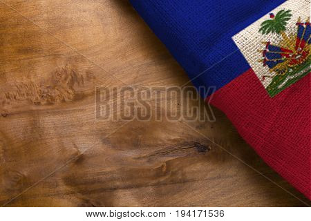 National flag of Haiti on a wooden background