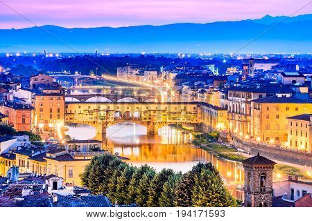 Florence Tuscany - Ponte Vecchio and Palazzo Vecchio at night Renaissance architecture in Italy.