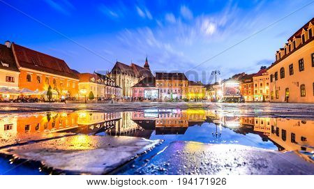 BRASOV ROMANIA - 29th JUNE 2017: Brasov Transylvania Romania - Twilight image with water reflection of Council House medieval downtown.