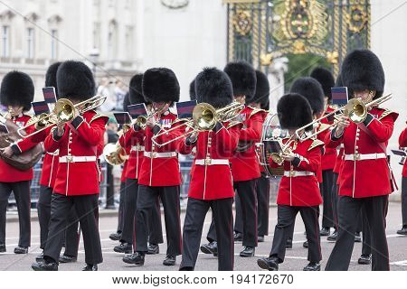 LONDON UNITED KINGDOM - JUNE 25 2017 : Ceremonial changing of the London guards in front of the Buckingham Palace Queen's Guard. This is one of the major attractions in London.