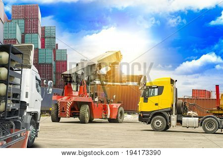 stacker and trailer truck load in or load out container box hold to train bogie in clear blue sky background for transportation ,import export concept