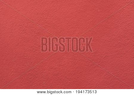 Red painted stucco wall. Background texture.