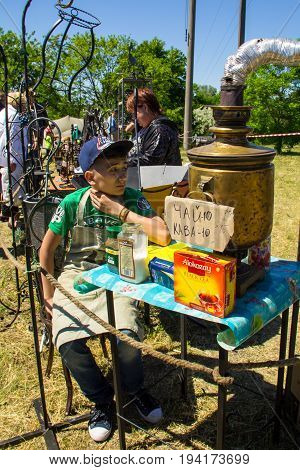 Boy Sells Tea From The Old Samovar On Strawberry Festival