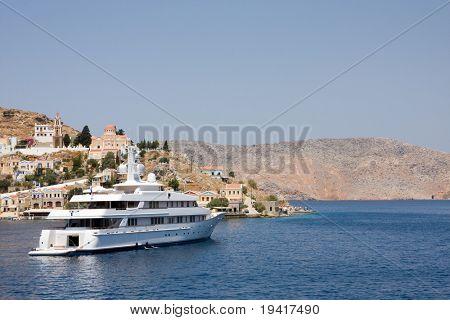Passenger ship leaving bay of Symi island, Greece