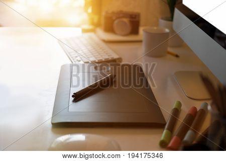 Closeup of a graphic designer's desk. workspace creative digital tablet and modern desktop computer.