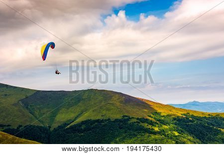 Skydiving flying in the clouds over the mountains. parachute extreme sport