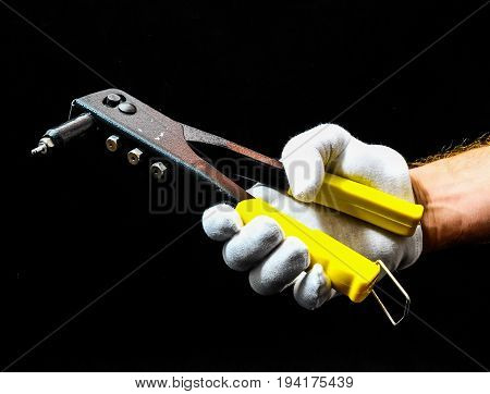 Rivets Pliers And A Hand