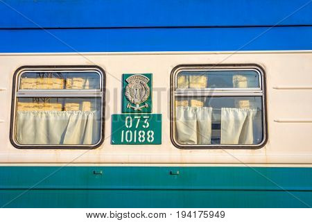 Windows with curtains of old colorful Uzbek train