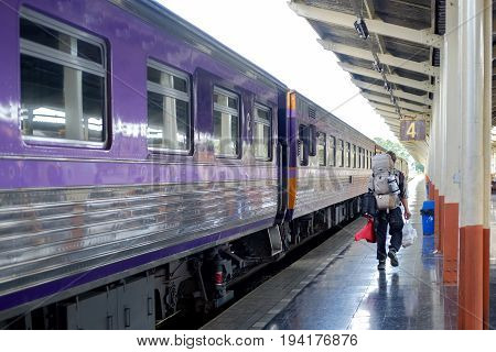Young traveler man in railway. Travel Concept.