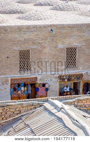Souvenir shops in tiny street from above Bukhara Uzbekistan