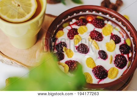 healthy and tasty breakfast with blackberry and tea with lemon