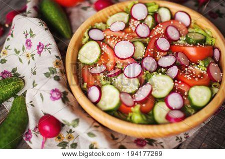 fresh vegetables salad in a wooden bowl
