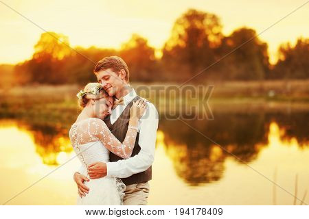 Portraits of a newly married couple. The wedding couple is standing on the background of the order. Lovers are happy.