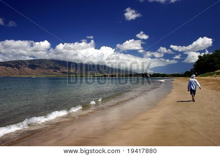 Someone walking on the beach in Kihei, Maui Island, Hawaii.