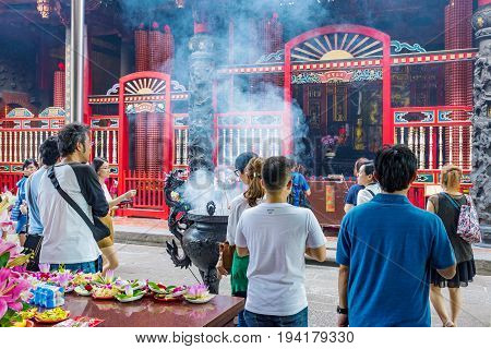 TAIPEI TAIWAN - JUNE 07: This is a scene of people praying at Longshan temple a famous buddhist temple and landmark in Taipei on June 07 2017 in Taipei