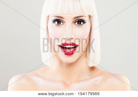 Surprised Woman with Open Mouth. Blondie Model with Makeup and Bob Hairstyle. Surprised Face Closeup