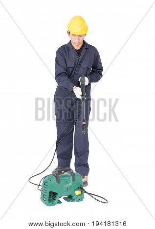 Young Man Stand And Holding High Pressure Water Gun