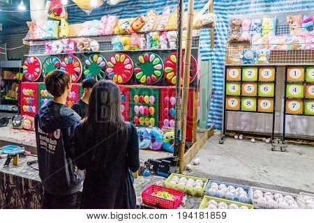 TAIPEI TAIWAN - MAY 20: This is a game in Shilin night market where people can win soft toys by hitting balloons with darts it is a common game across many night markets on May 20 2017 in Taipei