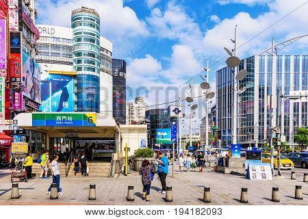 TAIPEI TAIWAN - MAY 17: This is a busy city scene of Ximen shopping district and MRT station exit in the downtown area on May 17 2017 in Taipei