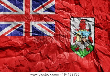 Bermuda flag painted on crumpled paper background