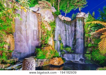 TAIPEI TAIWAN - MAY 11: This is a waterfall and garden area in Longshan temple a famous buddhist temple in Taipei on May 11 2017 in Taipei