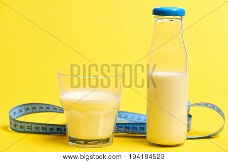 Milk In Glass And Bottle With Blue Measure Tape