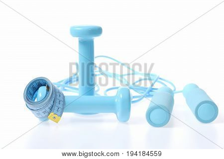 Duet Of Barbells And Skipping Rope Next To Measuring Tape